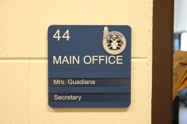 Marquee office sign with Tactile & Braille, school logo and two window units