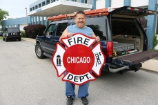 Installer Jack, holding a Dimensional Chicago Fire Department Logo (O'Hare)