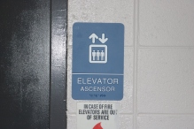 Red Oak Elementary School (Highland Park, IL); Elevator ADA compliant sign with Spanish copy