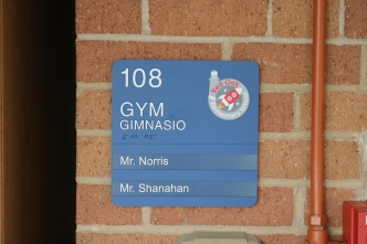 Red Oak Elementary School (Highland Park, IL); Gymnasium ADA compliant sign with Spanish copy + 2 window units