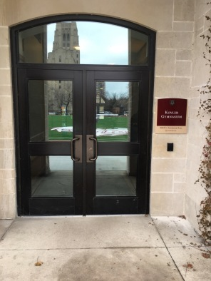 Kolver Gymnasium (University of Chicago) Exterior Grade, multi-layered, Directional Sign