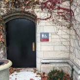 Girls locker room sign (University of Chicago); Exterior grade ADA Tactile and Braille Sign