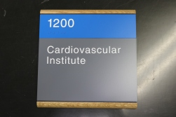 NorthShore University HealthSystem (Northbrook, IL); ADA Tactile and Braile Room Sign with Wooden Frame