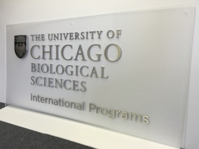 University of Chicago; Cap and Barrel sign on frosted Acrylic