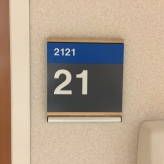 Highland Park Hospital (2121); ADA Tactile and Braille Room Sign with Wood Frame + Message Holder