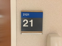 Highland Park Hospital (2121); ADA Tactile and Braille Room Sign with Wood Frame + Message Holder