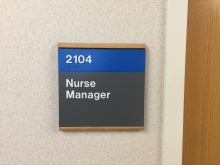 Highland Park Hospital (Nurse Manager); ADA Tactile and Braille Room Sign with Wood Frame