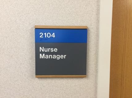 Highland Park Hospital (Nurse Manager); ADA Tactile and Braille Room Sign with Wood Frame