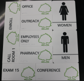 ADA Tactile and Braille, White, Phenolic Photopolymer signs with Raised Black Copy and PMS 377C Tactile OSH Tree and Tactile Black Men/Women Pictograms