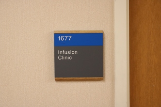 NorthShore University HealthSystem (Skokie, IL); ADA Tactile and Braille Room Sign with Wood Frame