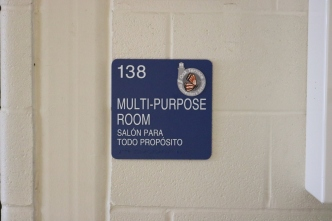 Oak Terrace Elementary School (Highland Park, IL); MPR ADA compliant sign with Spanish copy