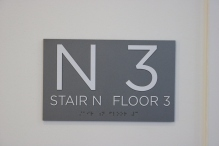 University of Chicago (Chicago, IL); ADA Tactile and Braille Stairwell Sign