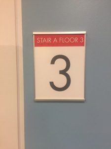 Pritzker Science Center (Illinois Institute of Technology); NovaPolymer Stairwell Sign with Tactile and Braille + Satin Aluminum Frame