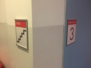 Pritzker Science Center (Illinois Institute of Technology); NovaPolymer Adjacent Stair and Stairwell Signs with Tactile and Braille + Satin Aluminum Frame