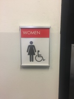 Pritzker Science Center (Illinois Institute of Technology); NovaPolymer Restroom Sign with Tactile and Braille + Satin Aluminum Frame