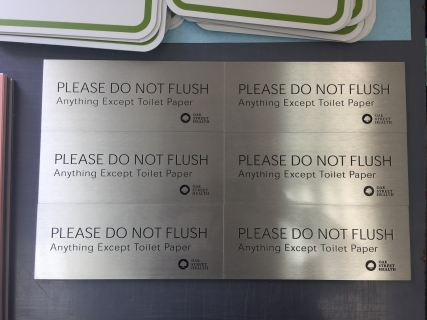 """Oak Street Health (Warwick, RI); 1/8"""" Etched Aluminum with Black-Filled Copy + Logo to read """"Please DO NOT FLUSH Anything but Toilet Paper"""""""
