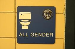 Highland Park High School (Highland Park, IL); ADA Tactile and Braille All Gender Restroom Sign + Logo