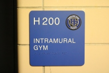 Highland Park High School (Highland Park, IL); ADA Tactile and Braille Room Sign + Logo