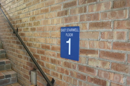 Northwood Junior High (Highland Park, IL); ADA Tactile and Braille Stairwell Sign