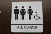 Oak Street Health (Memphis, TN); ADA Tactile and Braille All Gender Restroom Sign