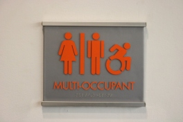 MTTC Building (Illinois Institute of Technology, Chicago); ADA Tactile and Braille Multi-Occupant Restroom Sign + Satin Aluminum Frame