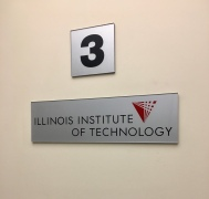 IIT Tower (Chicago, IL); Second Surface Painted, IIT Branded, Elevator Cab Sign